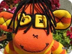 sock monkies orange and yellow sock monkey