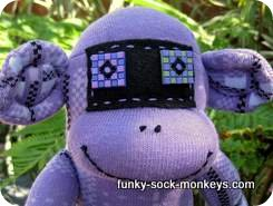 purple sock monkey face