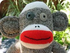 red heel socks sock monkey face